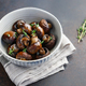 Roasted champignons with thyme in a ceramic bowl. Simple taste recipe. - PhotoDune Item for Sale