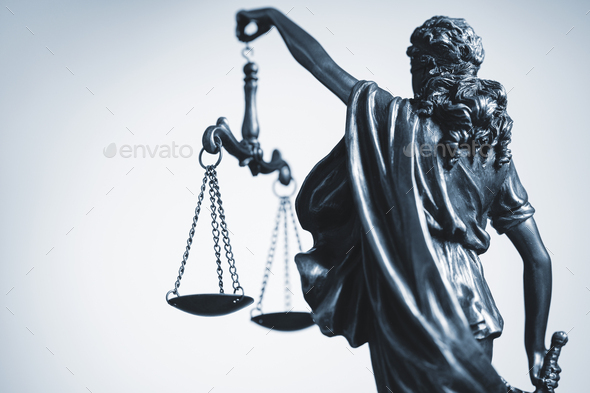 Cropped view of statue of Justice with the scales - Stock Photo - Images