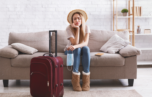 Travel cancel and sad woman stay at home - Stock Photo - Images