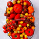 Various Fresh  Tomatoes in an iron basket .Food or Healthy diet concept. - PhotoDune Item for Sale
