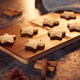 Freshly Baked Star Shaped Christmas Cookies On Board Ready For Decoration - PhotoDune Item for Sale