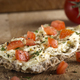 Crispbread with melted cheese and pieces of cherry tomatoes - PhotoDune Item for Sale