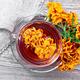 Tea herbal of marigolds in glass cup on board top - PhotoDune Item for Sale