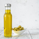 Bottle of olive oil with green olives - PhotoDune Item for Sale