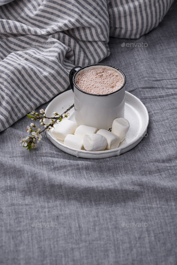 Cup of coffee or cocoa on the bed - Stock Photo - Images