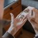 Senior disinfects hands with antibacterial gel - PhotoDune Item for Sale