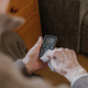 Old Man Cleaning phone to prevent Covid-19 infection - PhotoDune Item for Sale