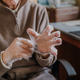 Elderly man puts on disposable protective gloves - PhotoDune Item for Sale