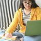 A female student with glasses is lacquer a lesson from her online study at home. - PhotoDune Item for Sale