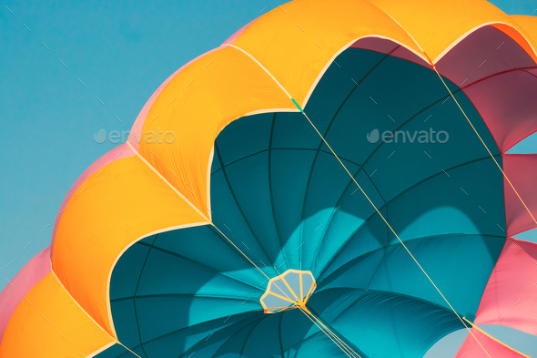 Close Multi-colored Parachute For Parasailing On Background Of Blue Sky - Stock Photo - Images