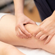 Physiotherapist woman doing a treatment on a woman's knee - PhotoDune Item for Sale