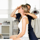 Physiotherapist inspecting her patient in a physiotherapy center - PhotoDune Item for Sale