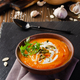 Tasty homemade rustic pumpkin soup with seeds in clay dish on slate tray - PhotoDune Item for Sale