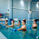Female swimmers group, aqua aerobics in the pool - PhotoDune Item for Sale