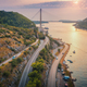 Aerial view of mountain roads  and beautiful bridge at sunset - PhotoDune Item for Sale