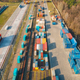 Aerial view of container loading and unloading at sunset - PhotoDune Item for Sale