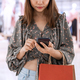 Young asian woman with shopping bags using smart phone and shopping at mall, Woman lifestyle concept - PhotoDune Item for Sale