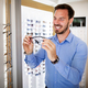 Health care, eyesight and vision concept - happy man choosing glasses at optics store - PhotoDune Item for Sale