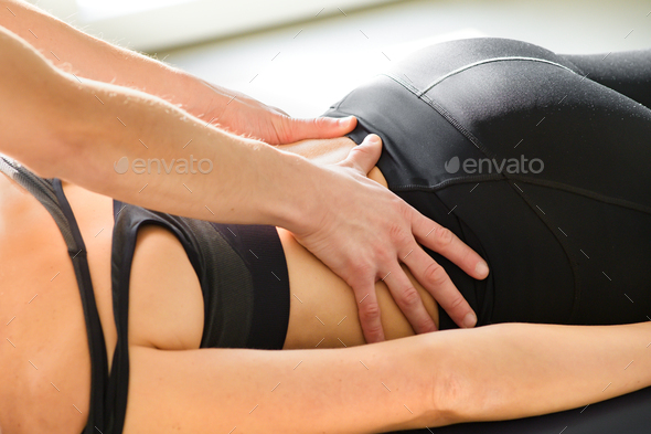 Osteopath doing sacral decompression osteopathy - Stock Photo - Images