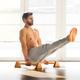 Man doing V sit pose on low bars - PhotoDune Item for Sale