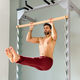 Man doing a pull up L sit in the hold position - PhotoDune Item for Sale