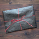 wrapped gift on a wooden table - PhotoDune Item for Sale