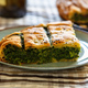 Spinach pie or greek spanakopita serving on kitchen table - PhotoDune Item for Sale