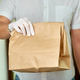 Courier delivers online purchases to the door during the coronavirus epidemic - PhotoDune Item for Sale