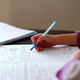 Unrecognizable girl doing homework, writing education concept, Coronavirus - PhotoDune Item for Sale