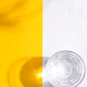 Top view of glass of fresh cold clean water on a duotone yellow white background with soft shadows - PhotoDune Item for Sale