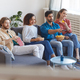 Multi Ethnic Group of People Watching TV at Home - PhotoDune Item for Sale