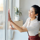 Young Asian Woman Cleaning Windows - PhotoDune Item for Sale