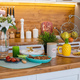 Easter kitchen with food on counter. View over wooden counter set with snacks - PhotoDune Item for Sale