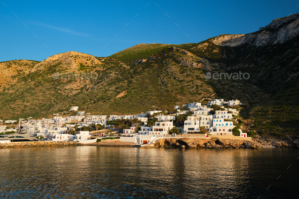 Kamares town with traditional white houses on Sifnos island on sunset. Greece - Stock Photo - Images