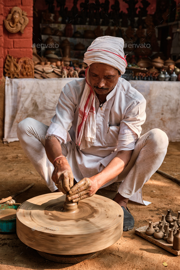 Indian potter at work, Shilpagram, Udaipur, Rajasthan, India - Stock Photo - Images