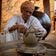 Indian potter at work. Handwork craft from Shilpagram, Udaipur, Rajasthan, India - PhotoDune Item for Sale