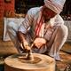 Indian potter at work, Shilpagram, Udaipur, Rajasthan, India - PhotoDune Item for Sale