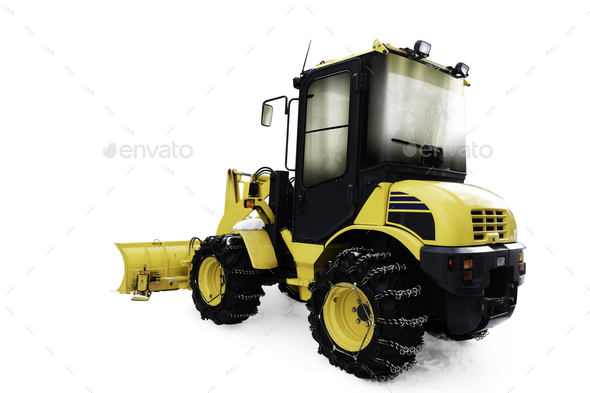 Yellow bulldozer in pile of snow - Stock Photo - Images