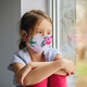 Little girl, child in mask sits on windows, coronavirus quarantine - PhotoDune Item for Sale