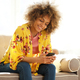 young woman sitting at home with mobile phone - PhotoDune Item for Sale