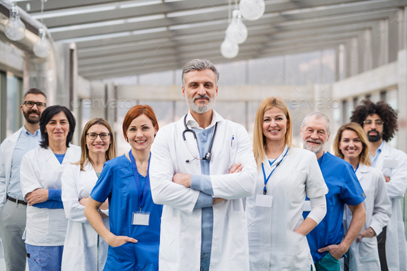 Group of doctors standing in hospital on medical conference. - Stock Photo - Images