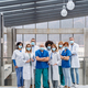 Group of doctors with face masks looking at camera, corona virus concept. - PhotoDune Item for Sale