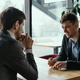 Two young businessmen discussing something - PhotoDune Item for Sale