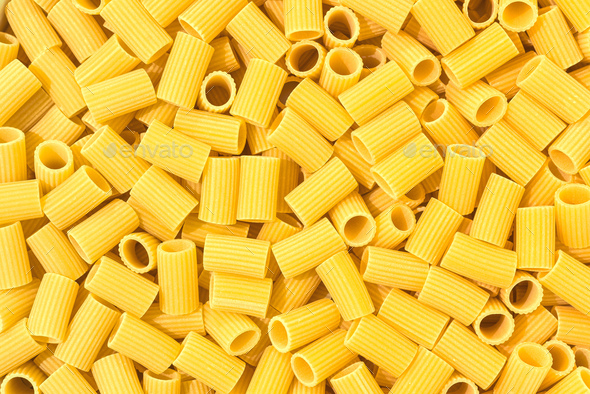 Italian Macaroni Pasta half sleeves striped raw food background or texture - Stock Photo - Images