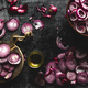 red onions cut into slices on a black background in rustic style. the view from the top. copyspace - PhotoDune Item for Sale