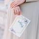 bride holding wedding invitation card - PhotoDune Item for Sale