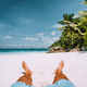 man resting on the white sand beach with beautiful palm trees - PhotoDune Item for Sale