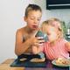 Siblings having breakfast together - PhotoDune Item for Sale