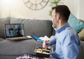 Man having video conference in the living room - PhotoDune Item for Sale