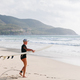surfing woman with surfing board on the beach - PhotoDune Item for Sale
